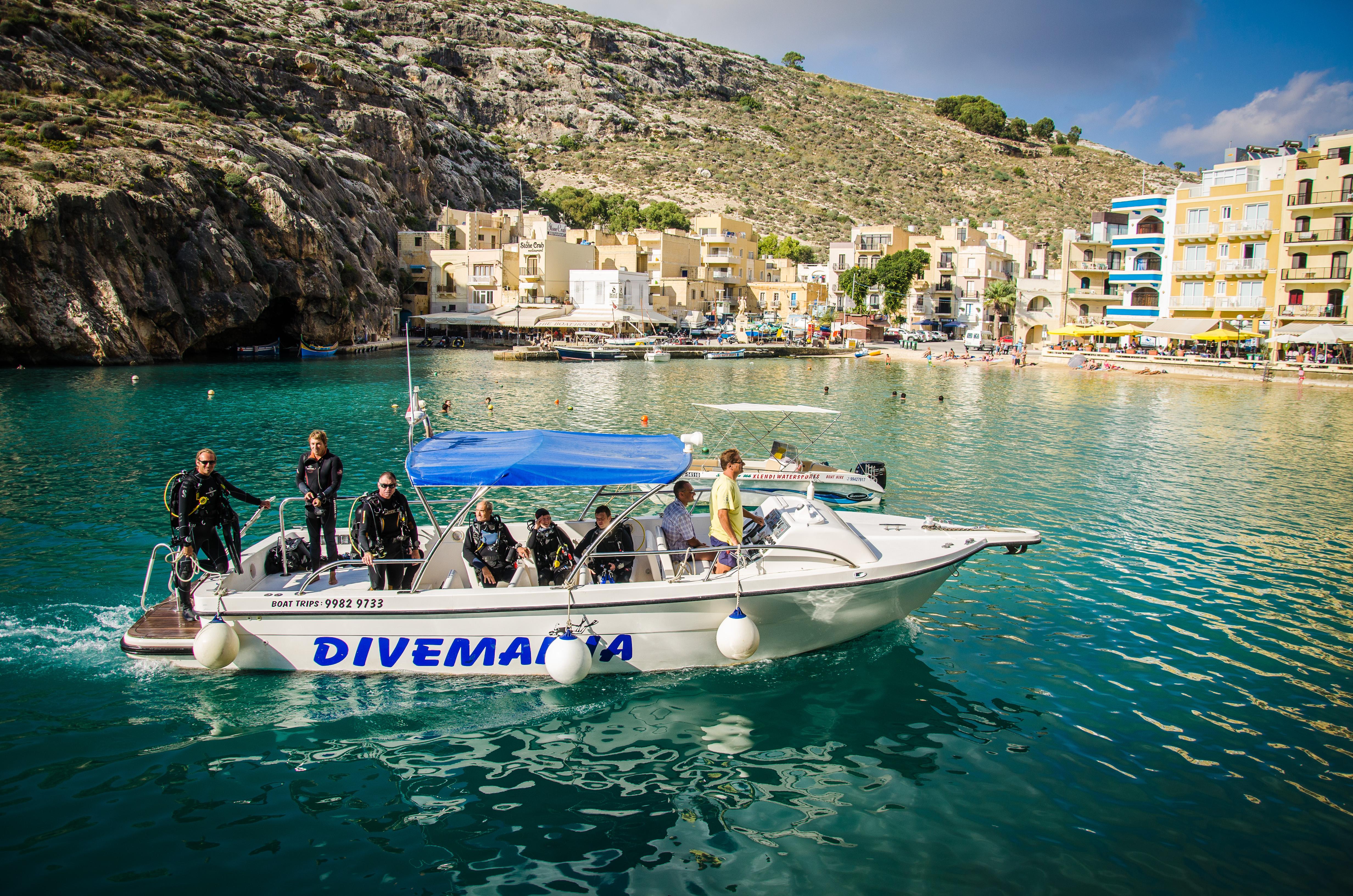 Divemania returning from a dive at Dawra Tas-Sanap