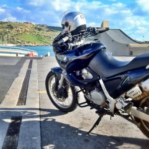 Driving through Gozo on motorbike