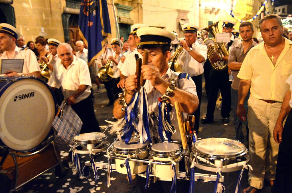 Band marches during a festa in Gozo