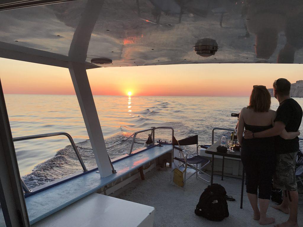 Gozo romantic sunset during boat ride