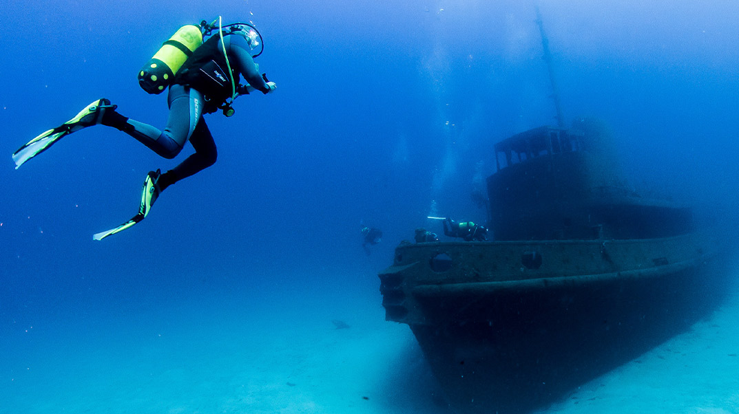 Diver approaching wreck in Gozo.